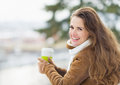 Portrait of happy young woman with hot beverage Stock Photography