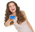 Portrait of happy young woman showing credit card isolated on white Royalty Free Stock Images