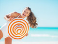 Portrait of happy young woman in swimsuit with beach hat having fun time on Royalty Free Stock Image