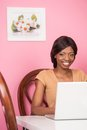 Portrait of happy young woman using laptop contented african american Royalty Free Stock Image