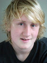 Portrait head shot teenage boy long blond hair Stock Image