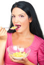 Portrait of healthy woman eating cereals Royalty Free Stock Images