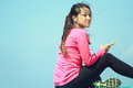 Portrait of healthy young woman sporty relaxing on bright sunny day Royalty Free Stock Photos
