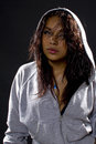 Portrait of a hip hop dancer latina wearing hoodie over black background Stock Photo