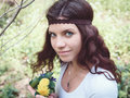 Portrait of hippie girl in forest with flowers Royalty Free Stock Photo
