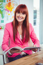 Portrait of a hipster businesswoman at her desk Royalty Free Stock Photo