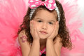 Portrait of hispanic child with hands on face dressed in princess costume Royalty Free Stock Image