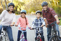 Portrait of hispanic family on cycle ride in countryside Royalty Free Stock Photography