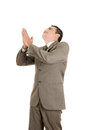 Portrait of a hispanic praying businessman this image has attached release Stock Photography