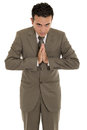 Portrait of a hispanic praying businessman this image has attached release Stock Photos