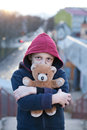 Portrait of a homeless boy with bear young Royalty Free Stock Photo