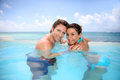 Portrait of honeymooners in swimming pool couple having fun Stock Photo