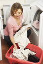 Portrait Of Housewife Doing Laundry Royalty Free Stock Photos