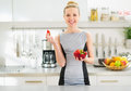 Portrait of housewife with plate of strawberries happy young in modern kitchen Royalty Free Stock Photos