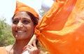 Portrait of an Indian Hindu woman waving saffron flag