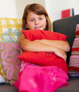 Portrait of a innocent young girl holding a pillow Stock Photography