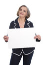 Portrait: isolated senior businesswoman holding a white sign for Royalty Free Stock Photo