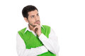 Portrait isolated young business man in green looking doubtful sideways Royalty Free Stock Image