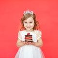 Portrait of joyful little girl with cake celebrating her birthday Royalty Free Stock Photo