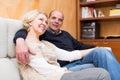 Portrait of joyful mature couple in home interior Royalty Free Stock Image