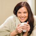 Portrait of joyful woman drinking hot beverage at home Stock Photos