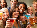 Portrait of joyful young people saying cheers Royalty Free Stock Photo