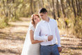 Portrait of just married wedding couple. happy bride, groom standing on beach, kissing, smiling, laughing, having fun in autumn pa Royalty Free Stock Photo