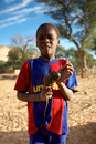 Portrait of a kid mali dogon land december unidentified dogon boy wearing unicef t shirt Royalty Free Stock Image