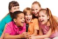 Portrait of kids singing together close up a group happy exited diversity looking boys and girls sitting on the coach in living Stock Photography