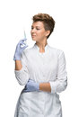 Portrait of lady surgeon showing syringe holding in his hand isolated on white background Stock Photo