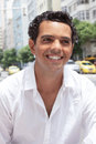 Portrait of a latin guy with toothy smile in the city Royalty Free Stock Photo