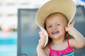 Portrait of laughing baby in hat Stock Photography