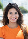 Portrait of a laughing caucasian woman in a orange shirt in the Royalty Free Stock Photo