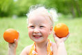 Portrait of laughing girl with oranges Royalty Free Stock Photo