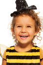 Portrait of laughing girl in striped bee costume Royalty Free Stock Photo