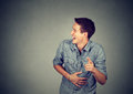 Portrait laughing young man pointing with finger Royalty Free Stock Photo