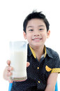 Portrait of little asian boy drinking a glass of milk isolated on white background Royalty Free Stock Image
