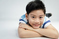Portrait of little asian cute boy on gray background Stock Image