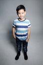 Portrait of little asian cute boy on gray background Royalty Free Stock Images