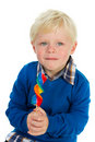 Portrait of a little boy eating a lolly Stock Photo