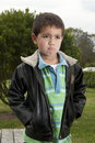 Portrait of little boy making pouty face Stock Photography