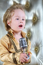 Portrait of a little boy in pop retro suit sings song Stock Photos