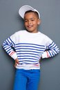 Portrait of a little boy smiling against gray background with hat Royalty Free Stock Photos