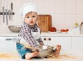 Portrait of a little chef hat and apron girl cooking spaghetti Stock Photos