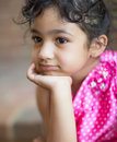 Portrait of a little child lost in thought concentration Stock Image
