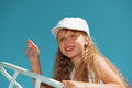 Portrait of little cute girl waving goodbye on a boat Royalty Free Stock Photo