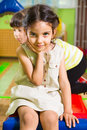 Portrait of little cute latin girl in daycare gym Stock Photos