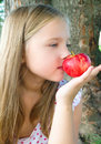 Portrait of a little girl with apple summer red Stock Photos