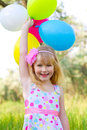 image photo : Portrait of little girl with balloons