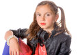 Portrait of a little girl with a black jacket and headphones on white Stock Photography